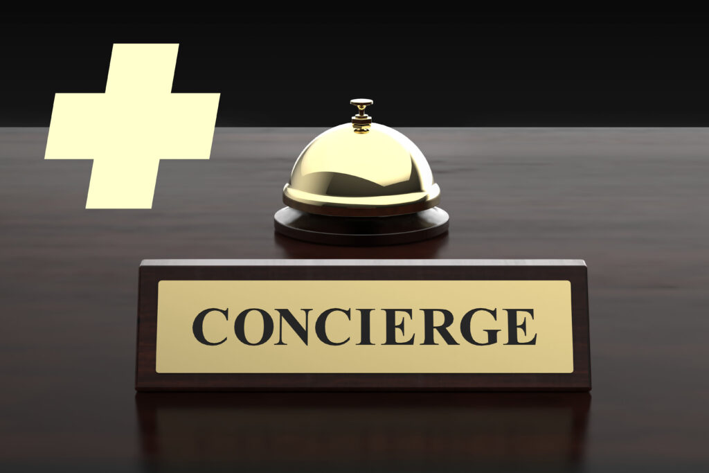 A bell on a desk with a sign that says concierge to signal the start of concierge care