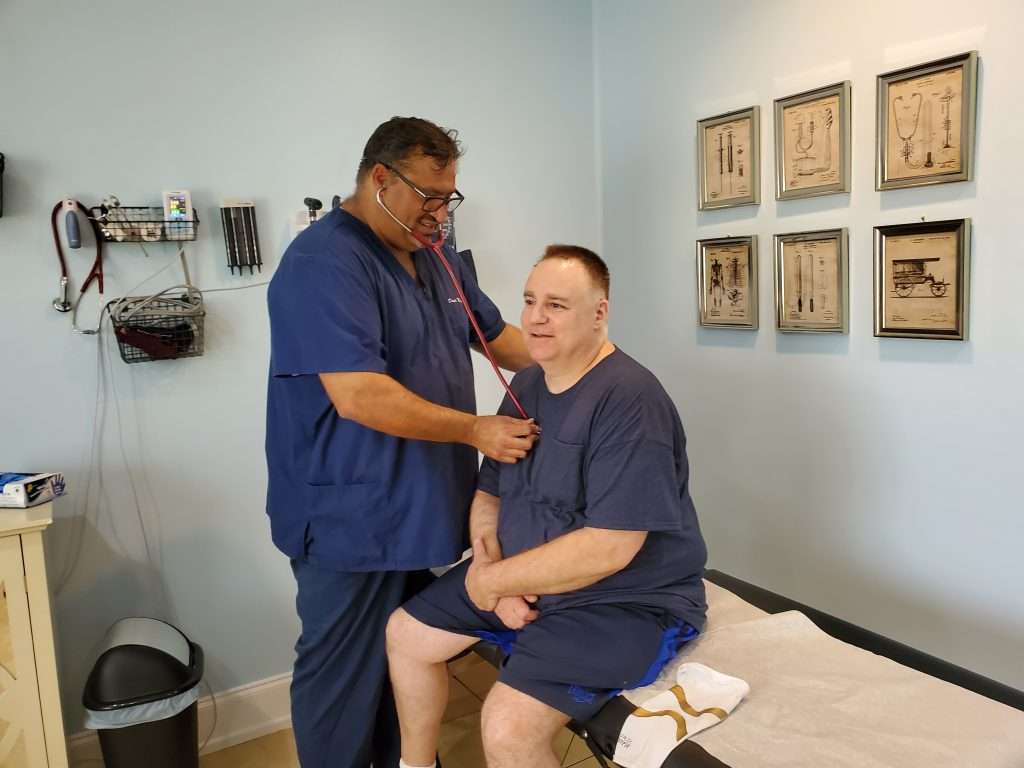 Dr. David Weitzman providing concierge care to one of his local North Myrtle Beach patients
