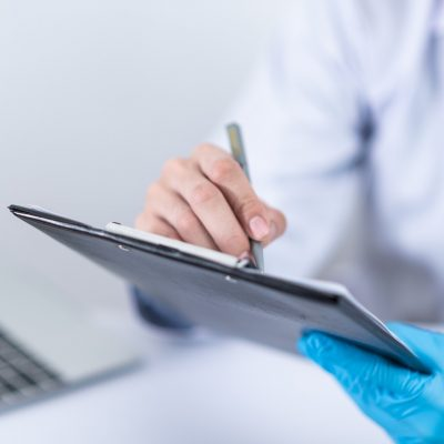 Doctor with tablet writing down notes for concierge care